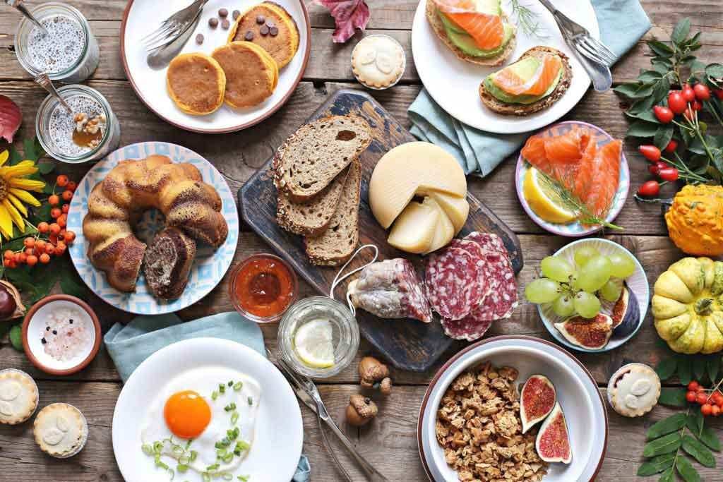 An aerial shot of various breakfast and brunch products on a wooden table