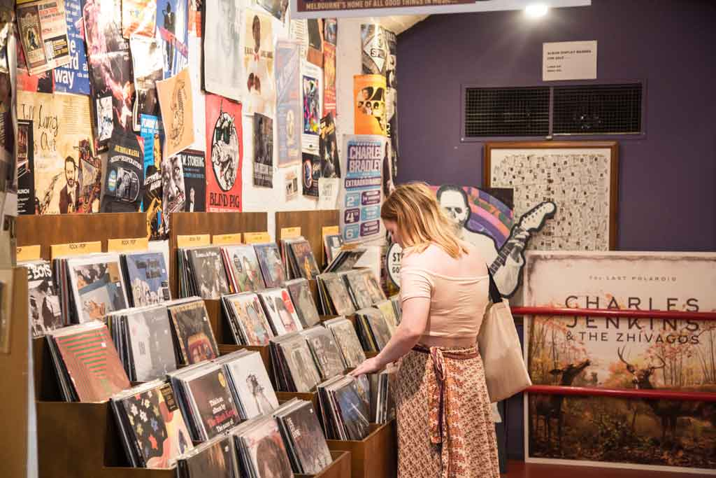 A record store with a woman browsing through different records