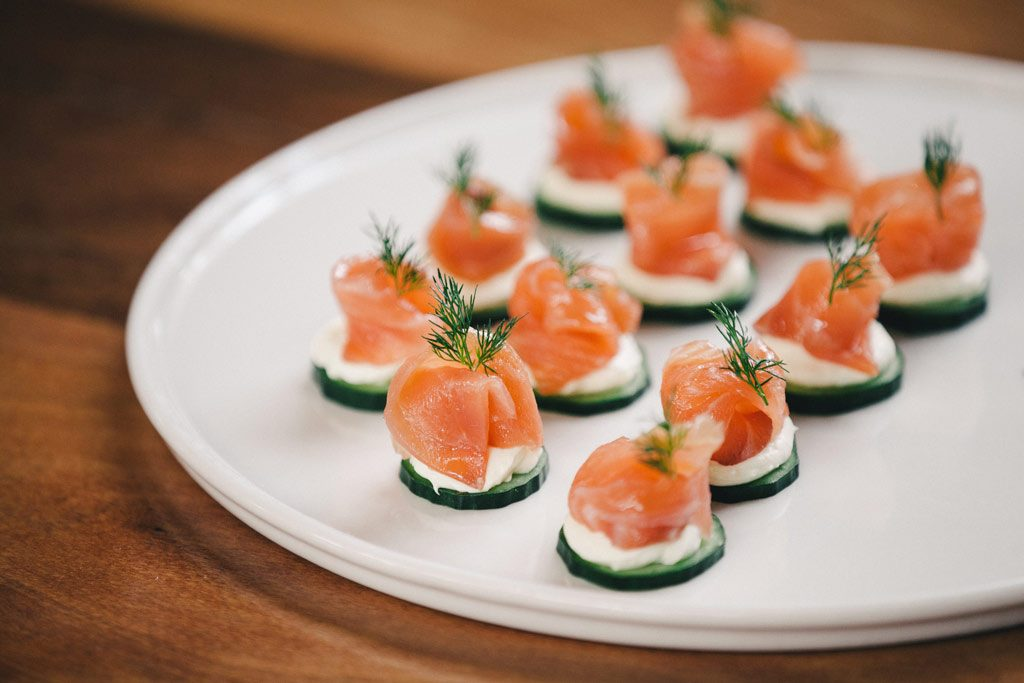 A plate of cucumber rounds topped with smoked salmon