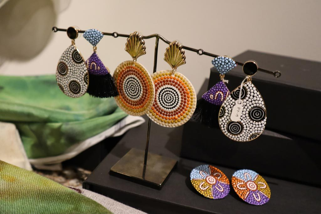 Different pairs of earrings hanging on a shop display