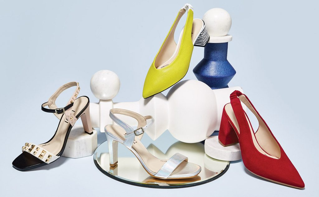 An assortment of stylish shoes on a light blue background