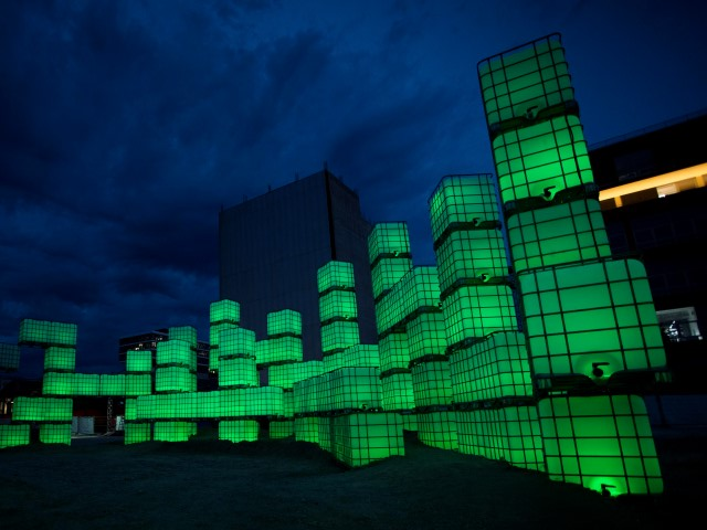 An outdoor installation made up of glowing cubes at night