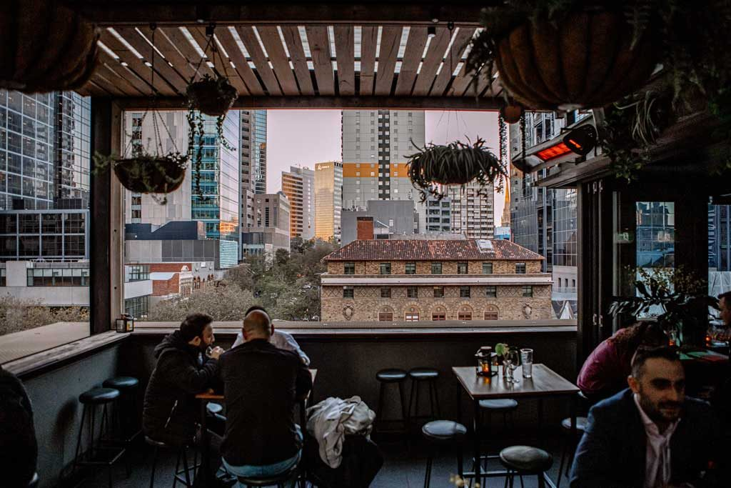 An outdoor area of a bar with views of the city