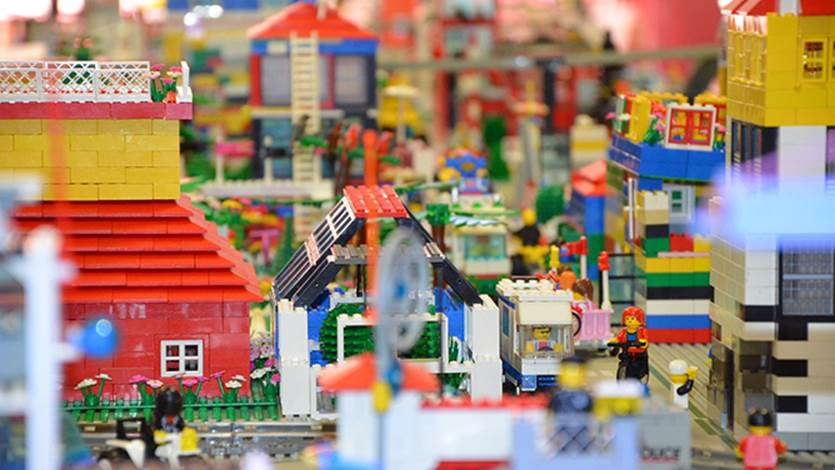 Colourful lego displays of houses and Lego people