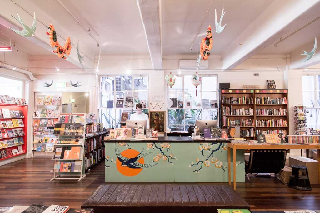 A book store with a colourful front desk