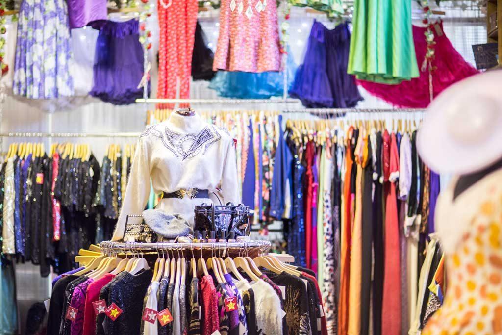 Racks of vintage clothing in a shop