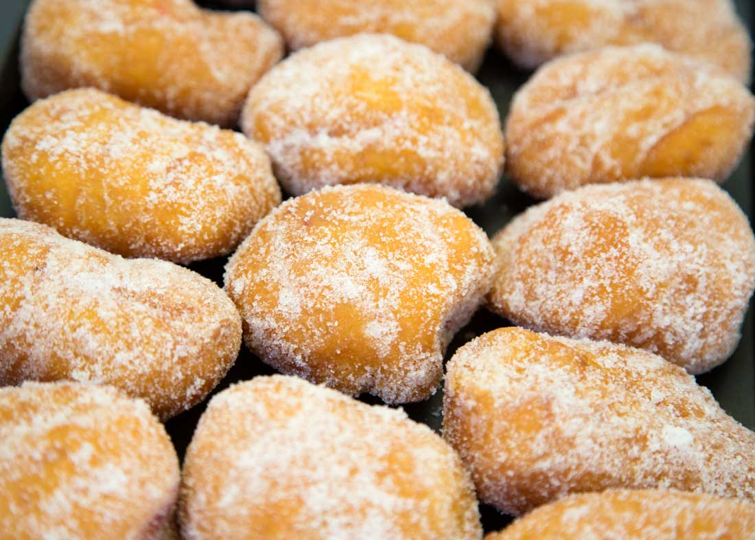 A stack of doughnuts covered in sugar