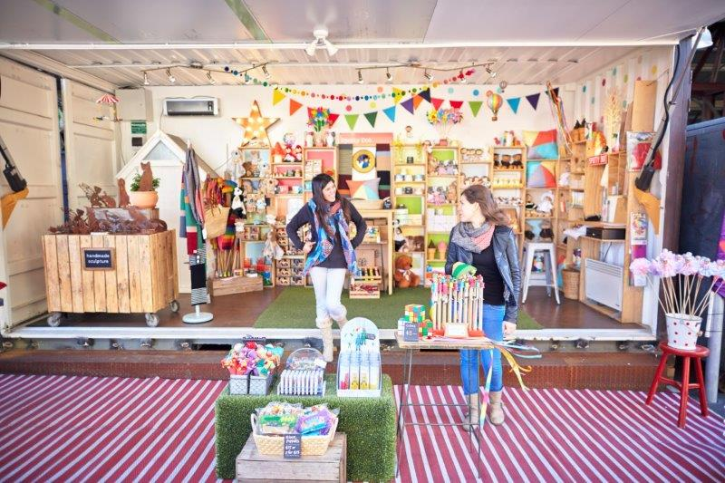 Picture of a shop with brightly coloured children's toys and gift ideas