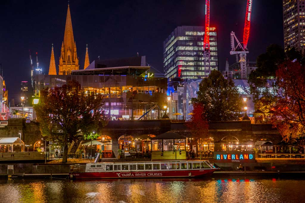 Businesses on the river lit up at night