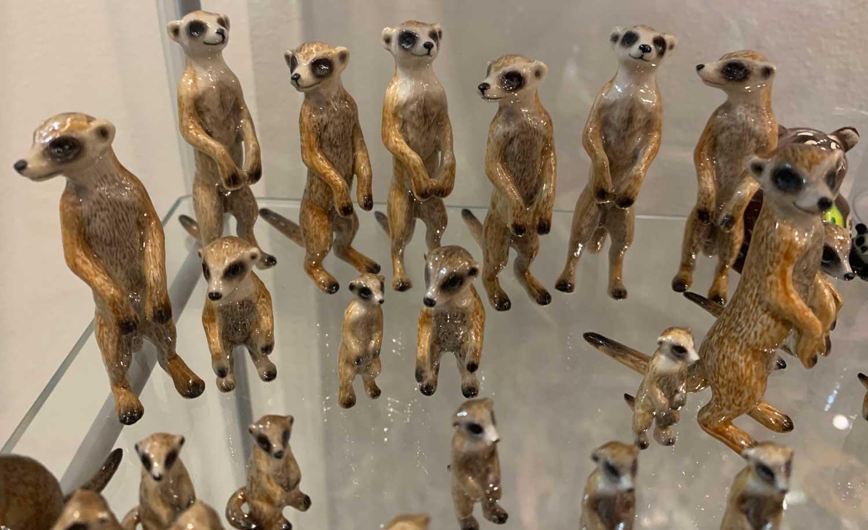 A display of tiny meerkat miniatures