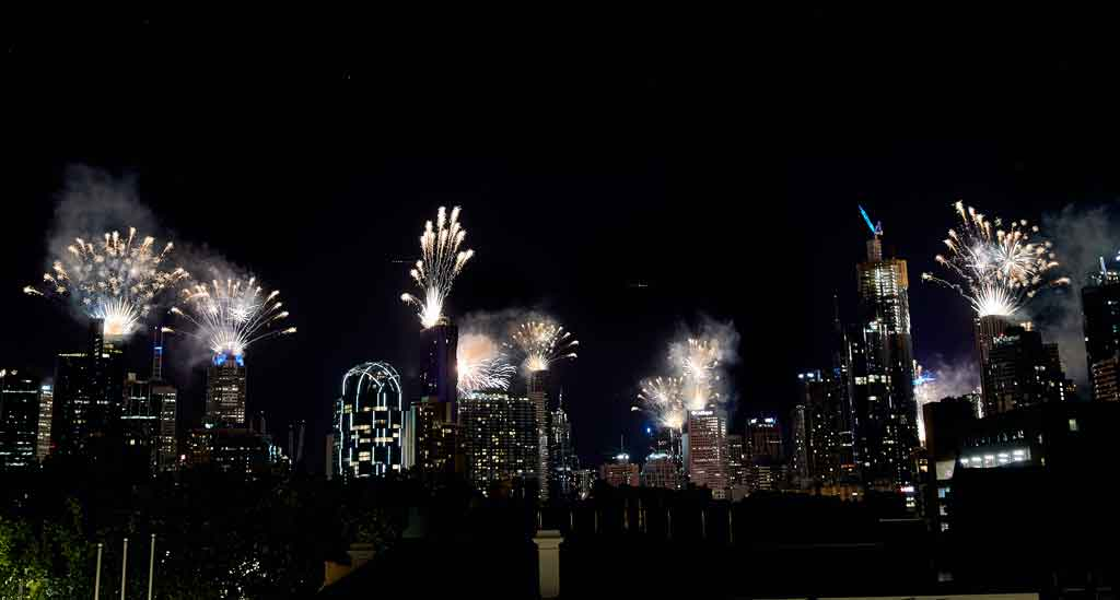 Fireworks lighting up a city skyline at night