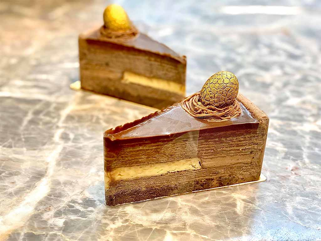 Decadent chocolate cake with golden easter egg on top