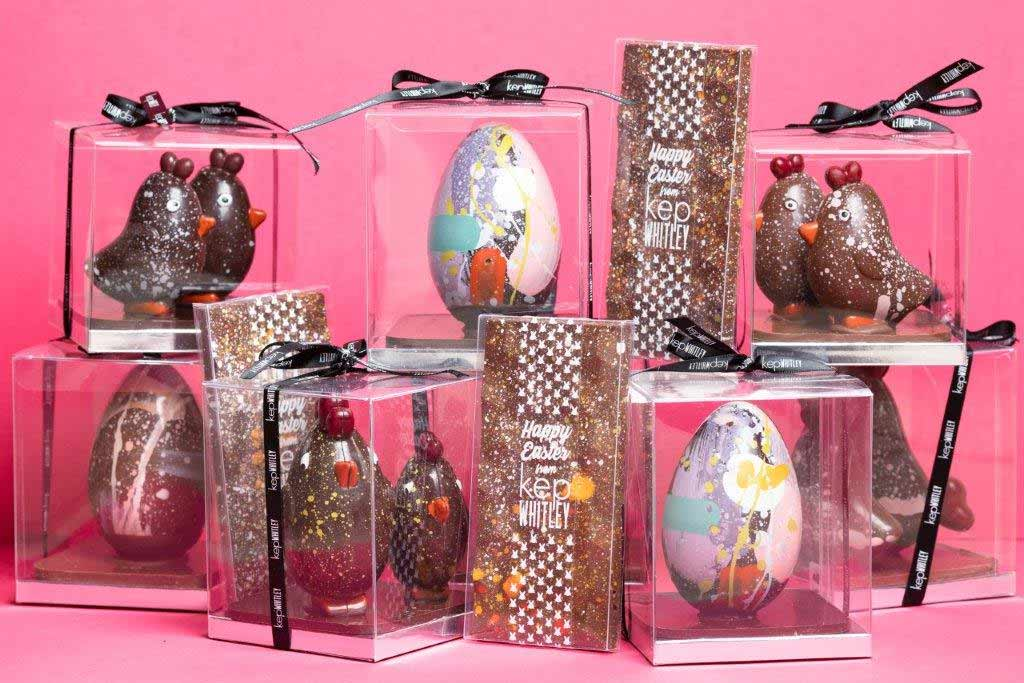 A selection of attractive hand painted Easter eggs on a pink background