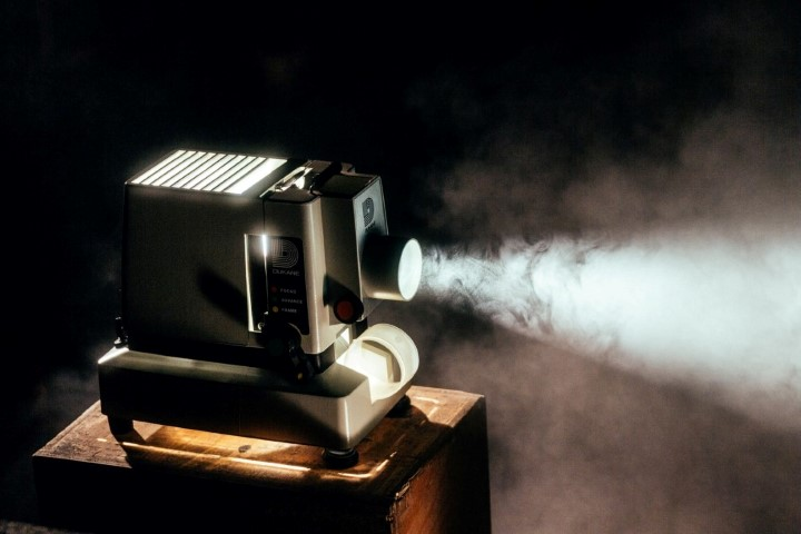 An old fashioned projector in the dark
