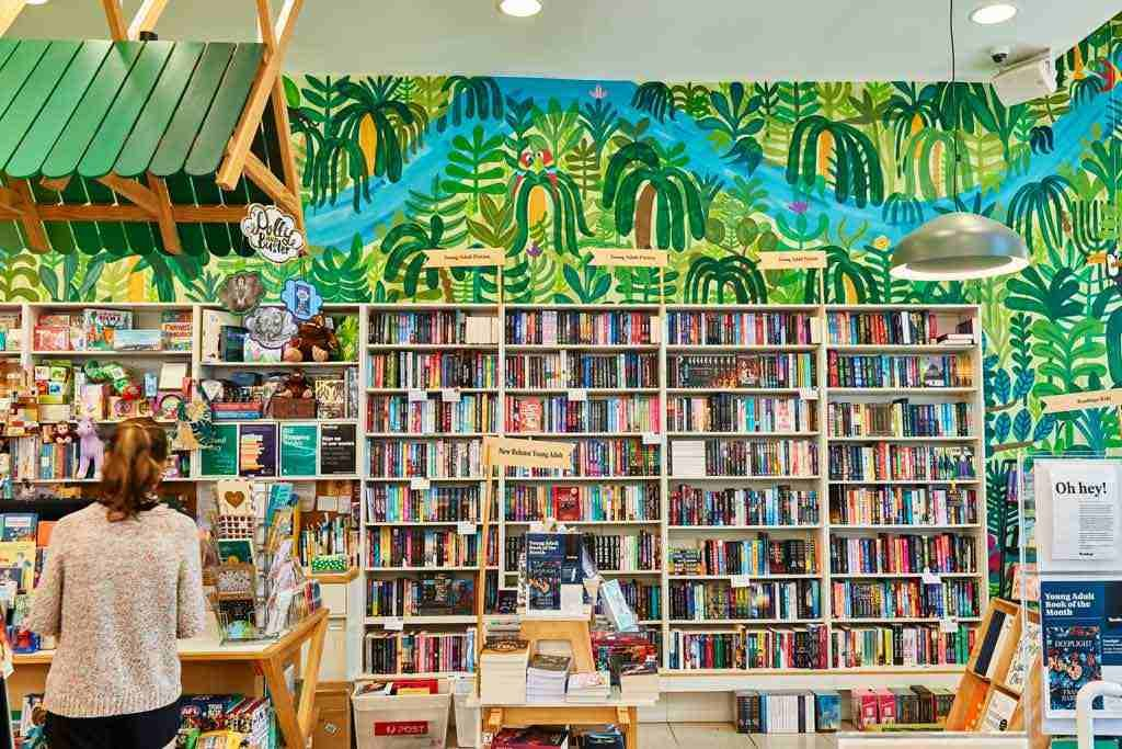 A brightly coloured store with book filled shelves