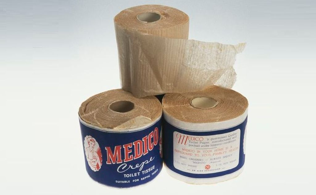 Three rolls of retro toilet paper on a white background