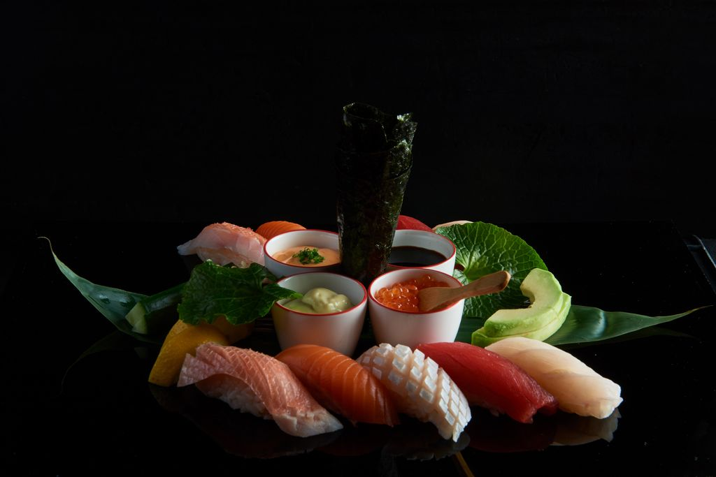 Sashimi and sushi on a black background