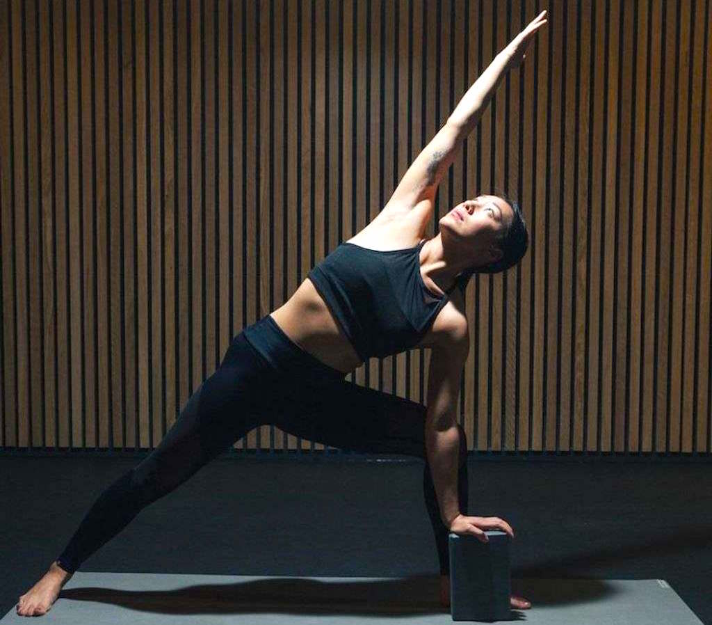 Person stretching in a yoga pose