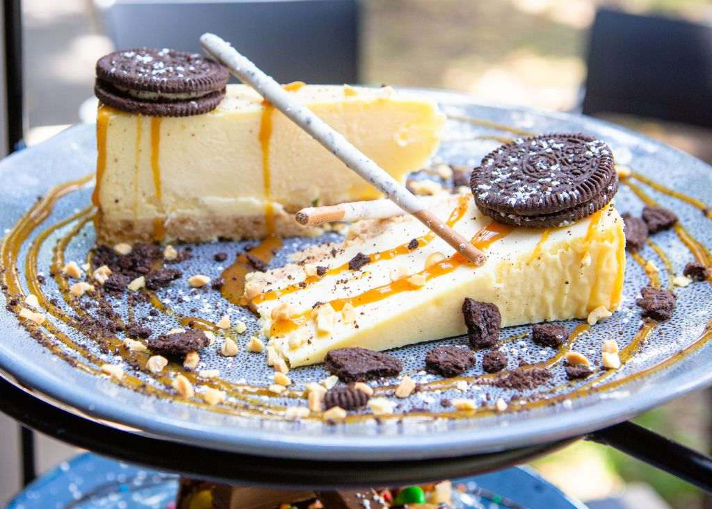 Two pieces of cheesecake on a blue plate