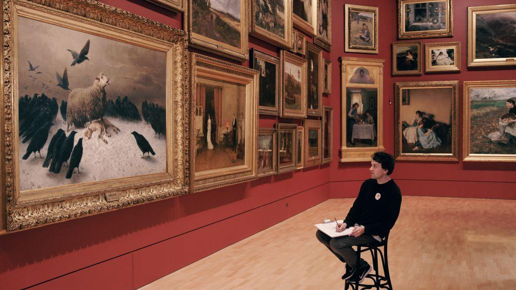 Person sitting and drawing in the National Gallery of Victoria