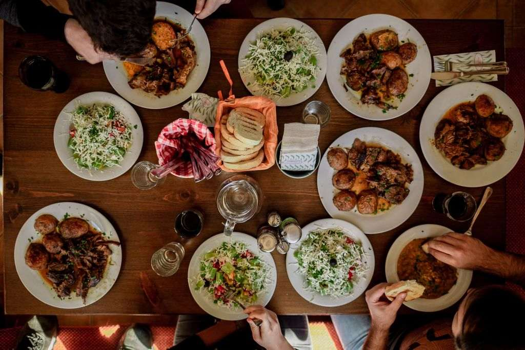 An aerial shot of a table with plates of food on it