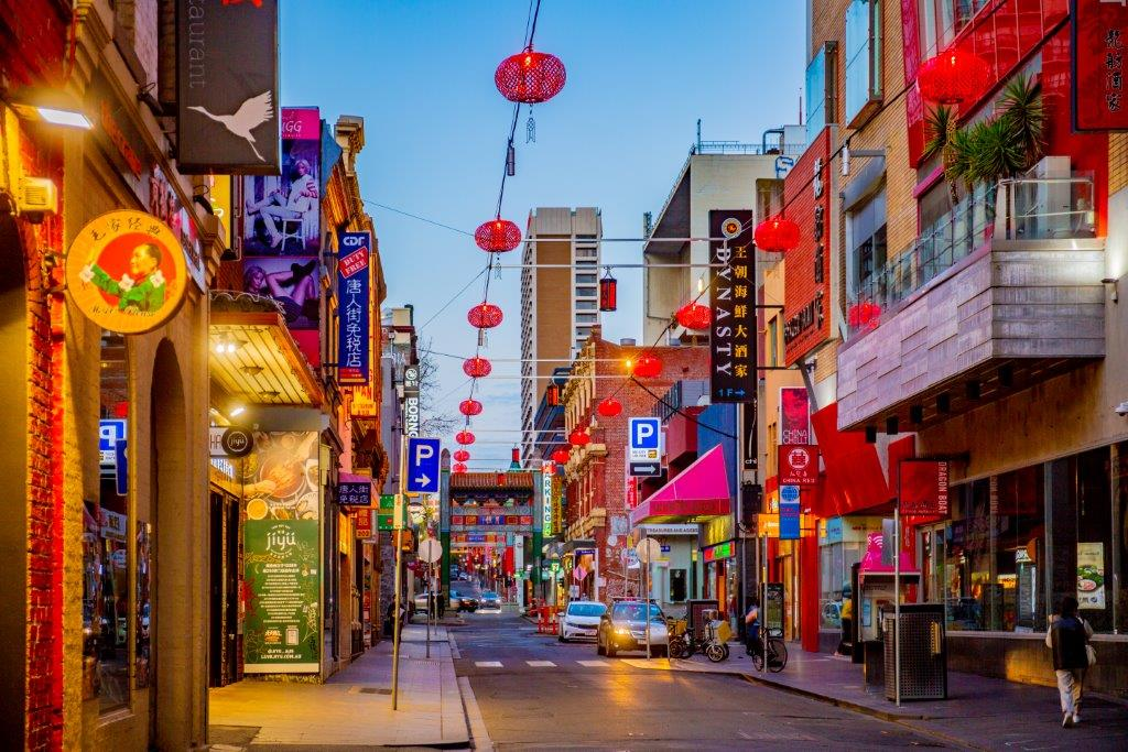 Chinatown lane covered in red and golden lanterns