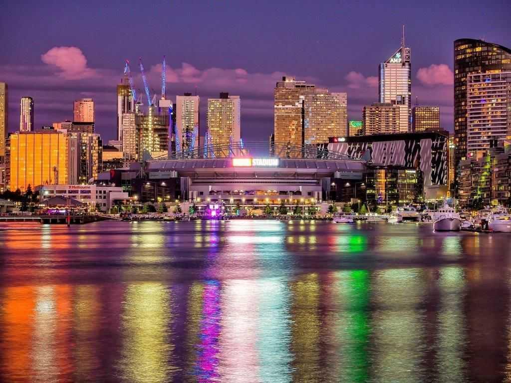 City lights splashing vibrant colours on the water