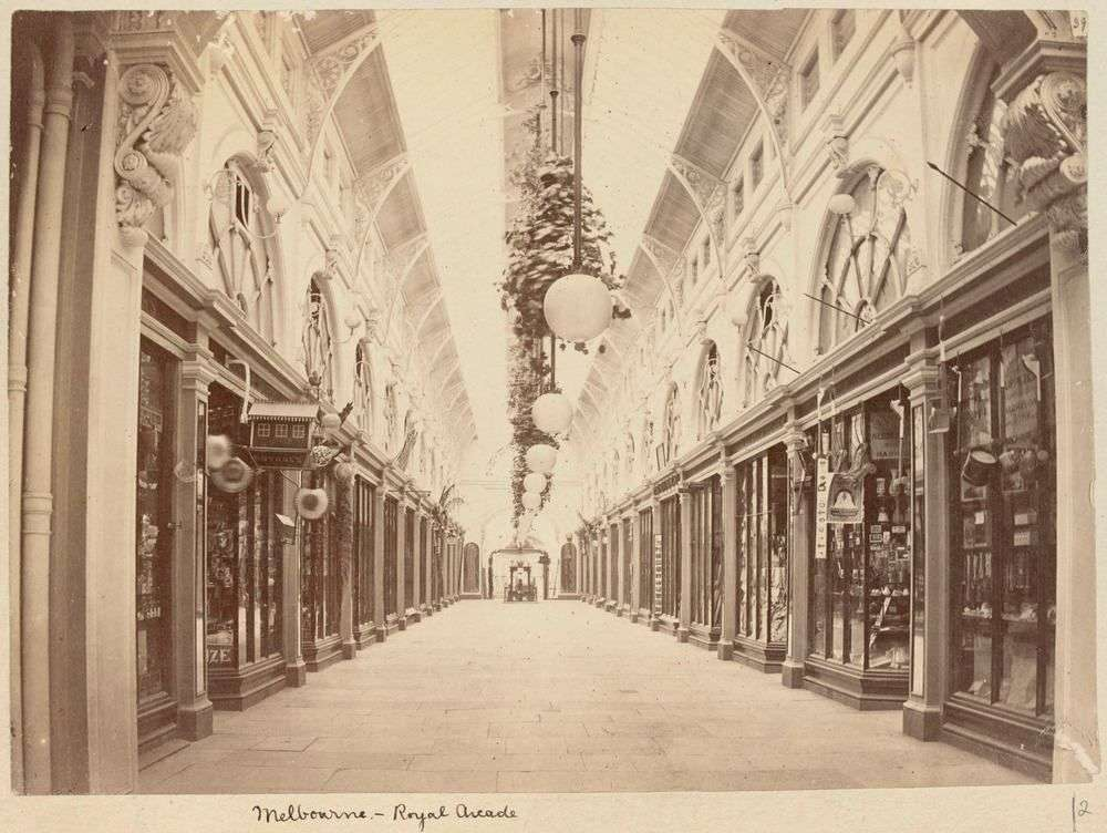 A black and white photo of a shopping arcade