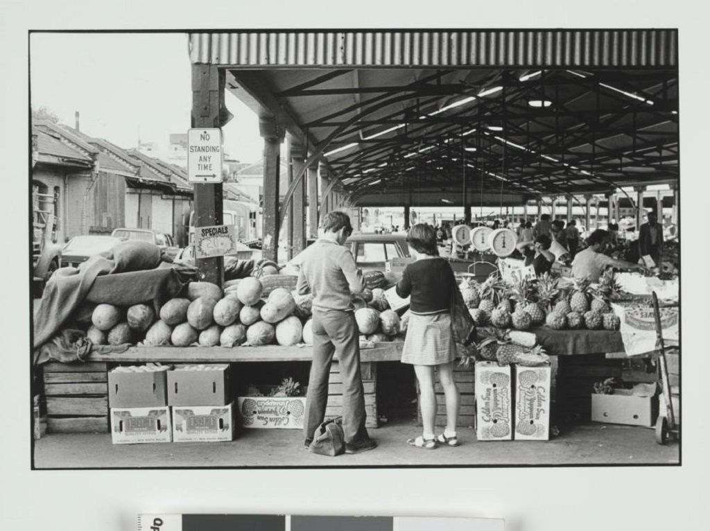 A black and white photo of a market