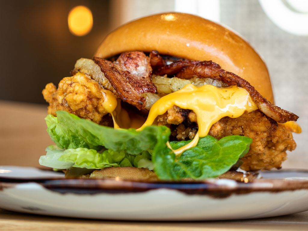 A fried chicken burger on a plate