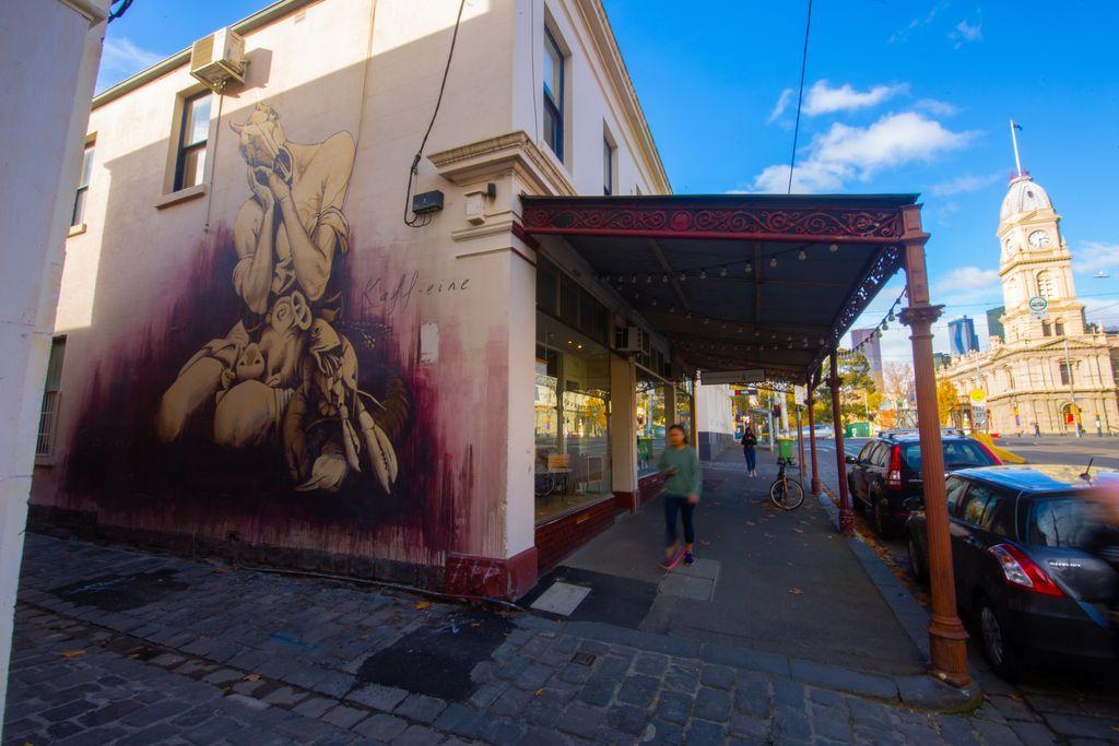 A street art mural in a laneway
