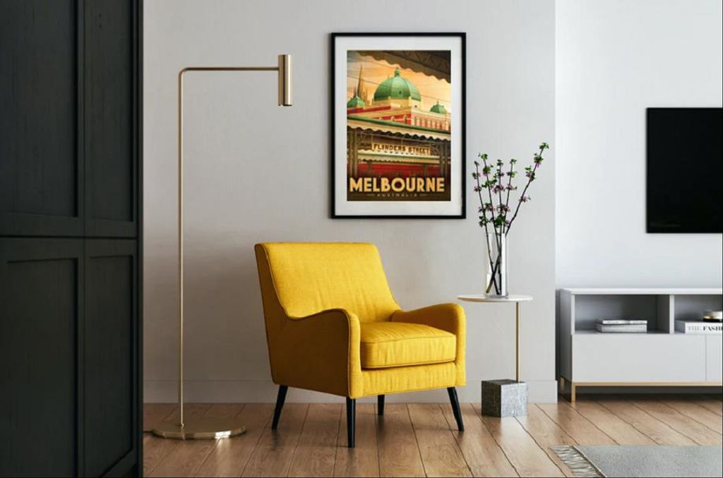 A living room with a yellow chair and a painting on the wall