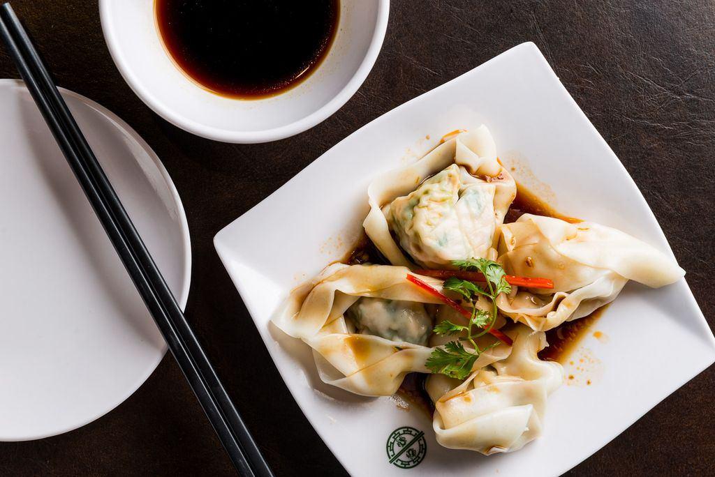 A plate with dumplings on it