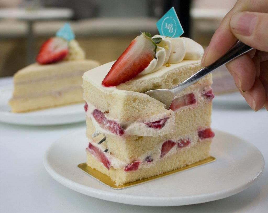 A layer cake with fruit and cream
