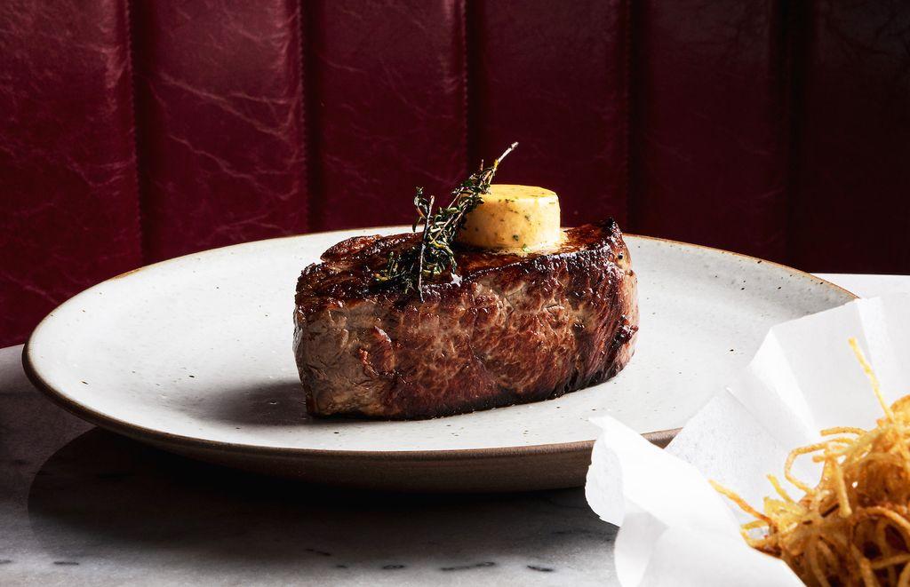 A steak on a white plate