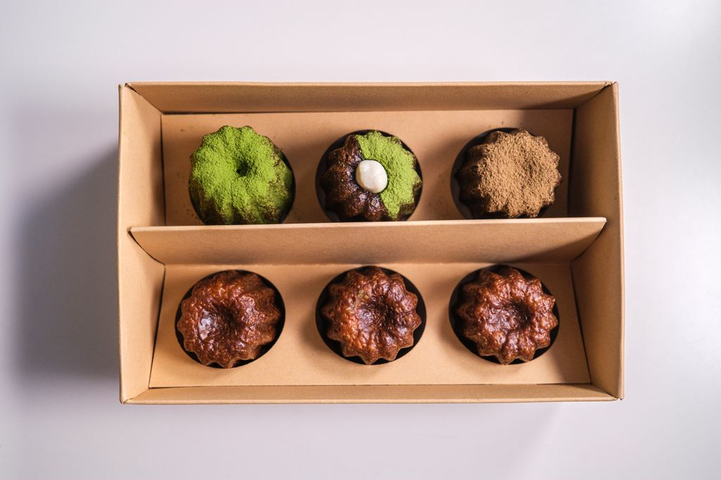 A cardboard box filled with small pastries
