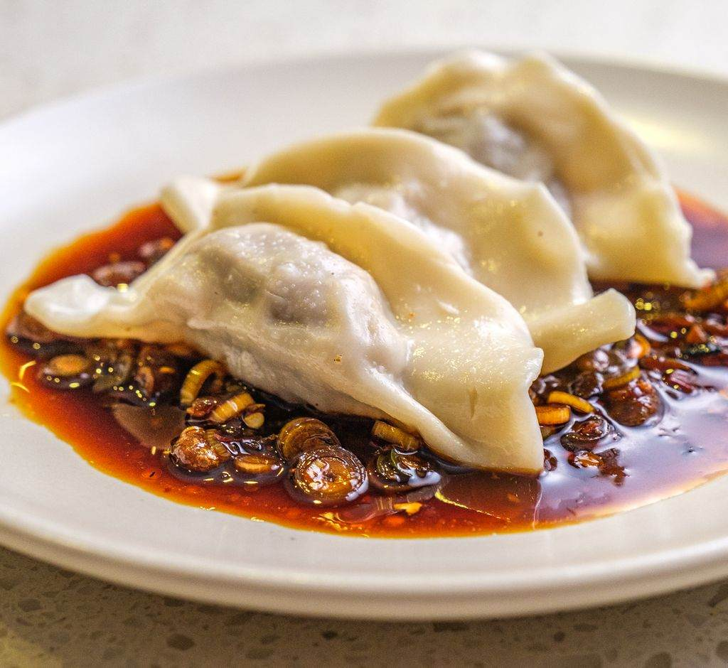Dumpling on a plate with chilli oil