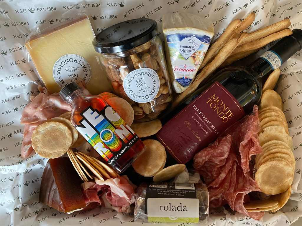 A box filled with Italian food and fresh produce