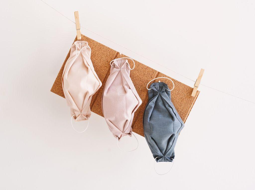 Masks hanging on a corkboard