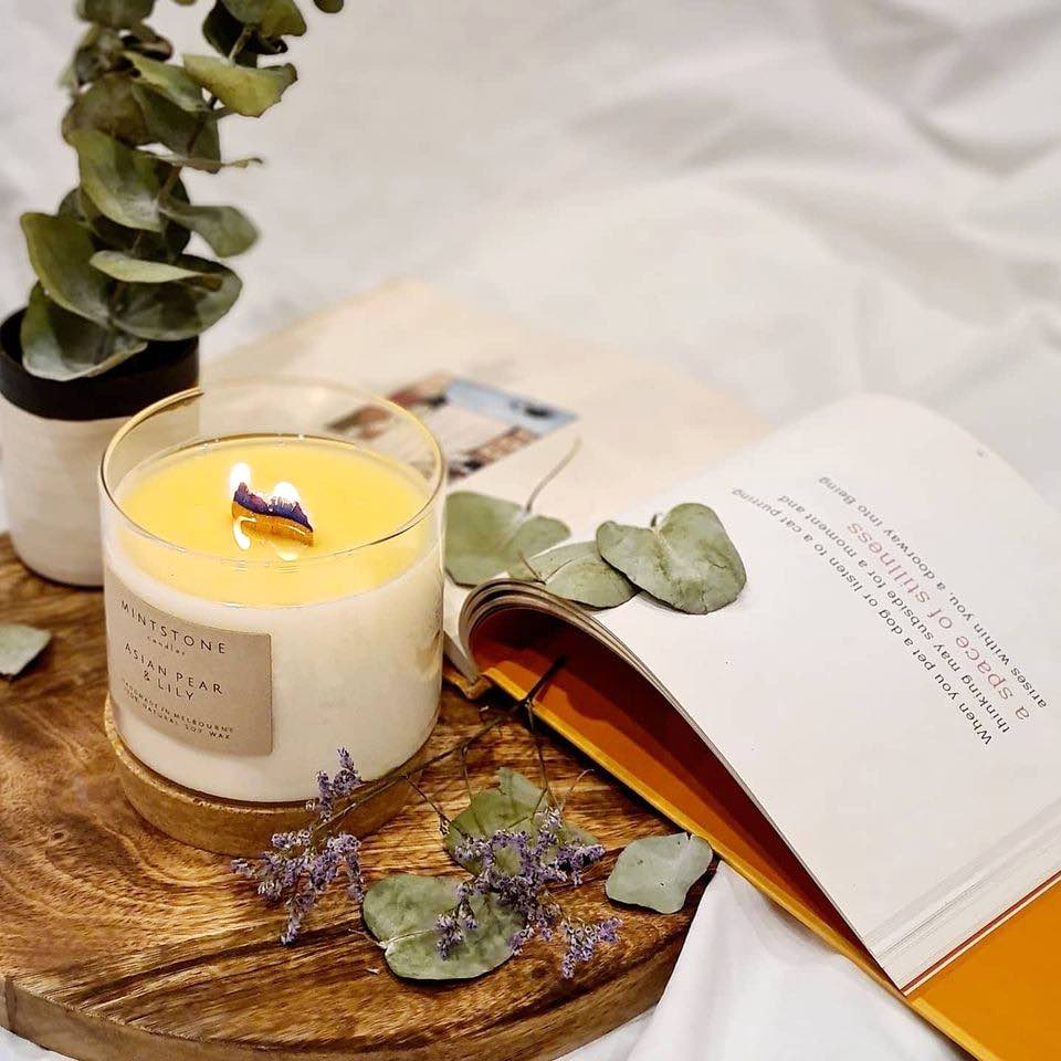 Mintstone candle, book and flowers