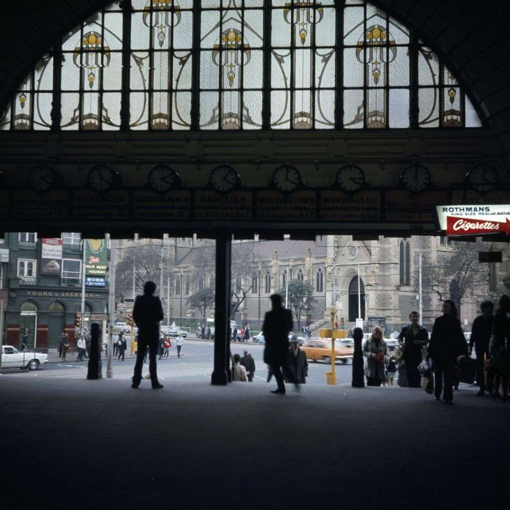 A colourised old photo of a train station