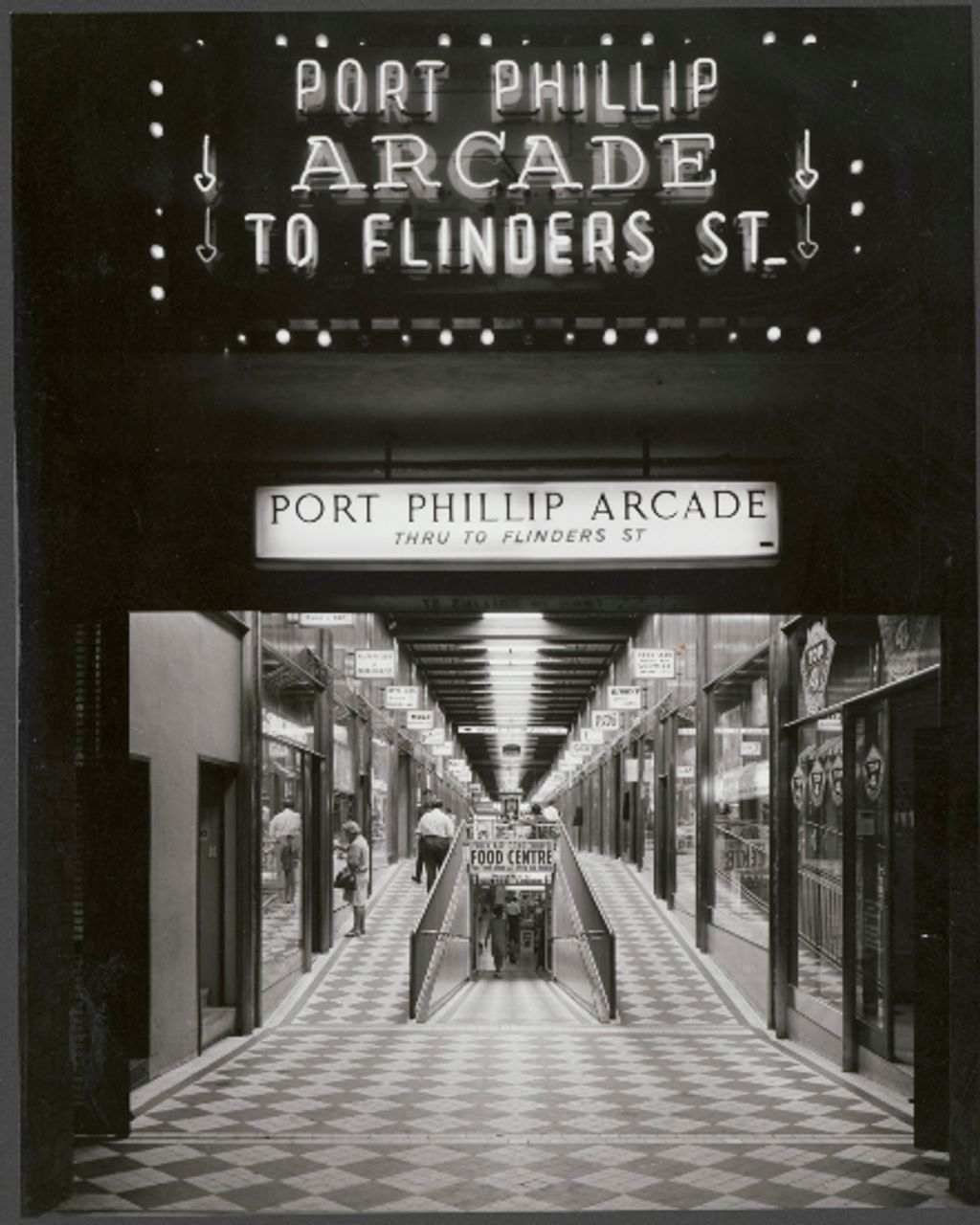 A black and white photo of an old arcade