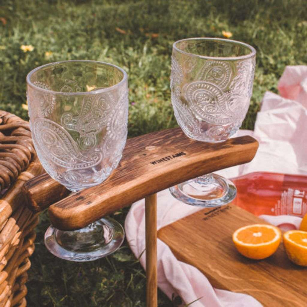 Two wine glasses in a wooden stand