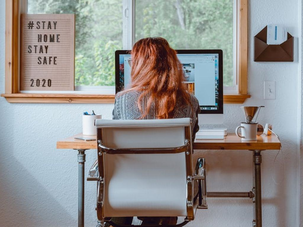 A woman sitting at a desk