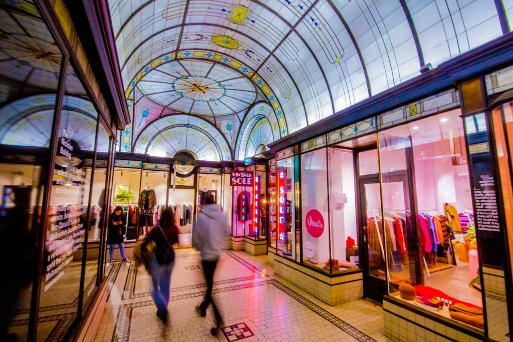 Two people walking in a shopping arcade