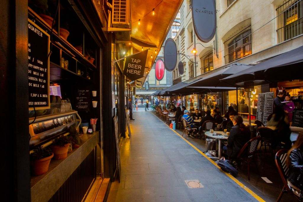 A cafe in a laneway with people eating