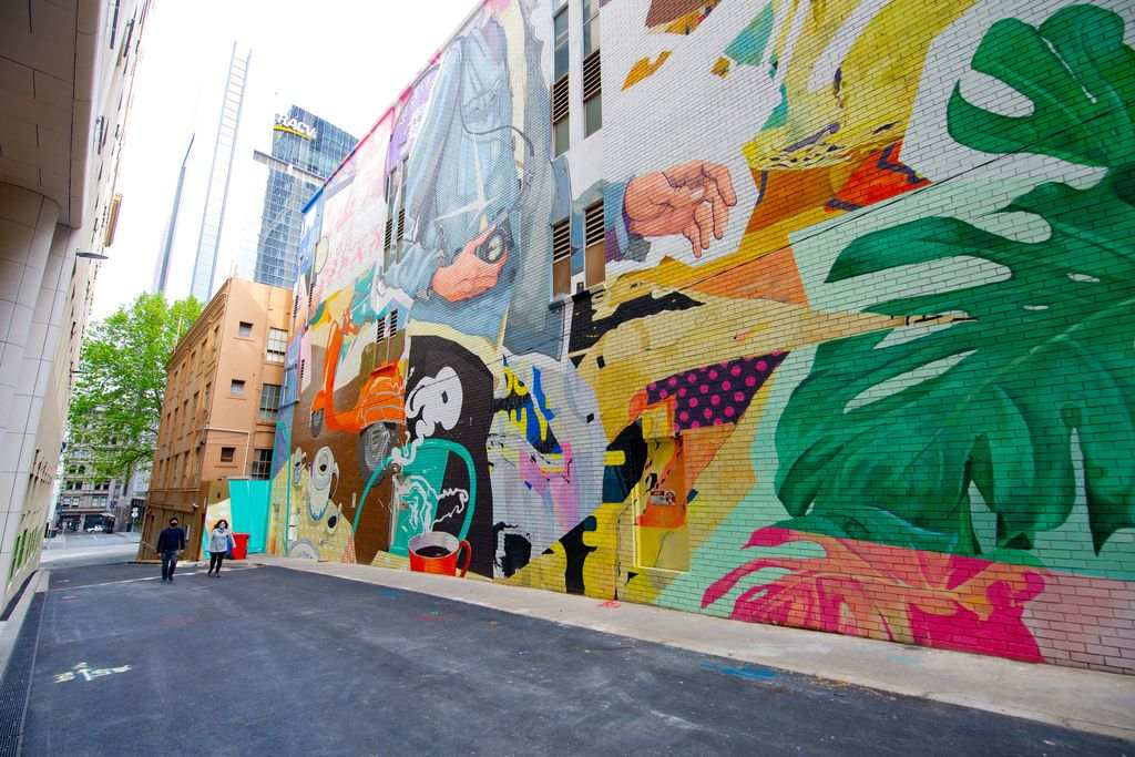 A large colourful mural on a tall wall