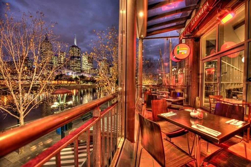 A restaurant balcony with a city view