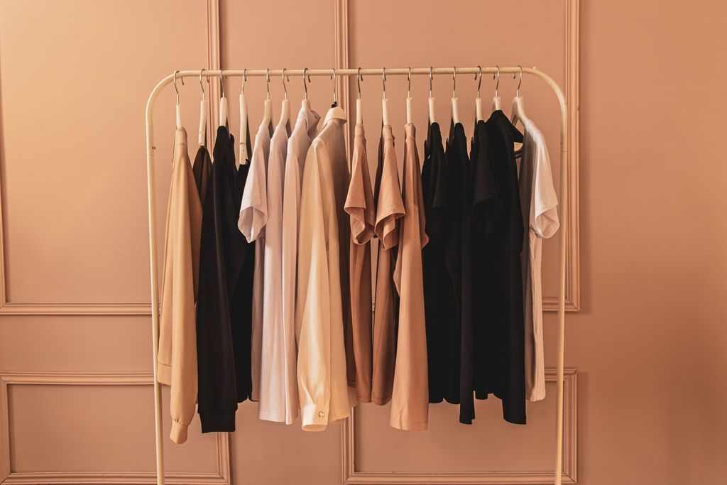 A clothes rack with t shirts hanging on it