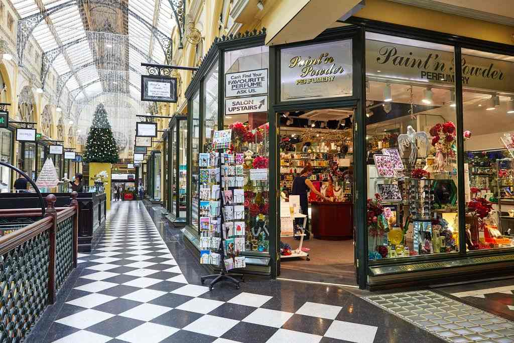 An old fashionaed shopping arcade with a Christmas tree